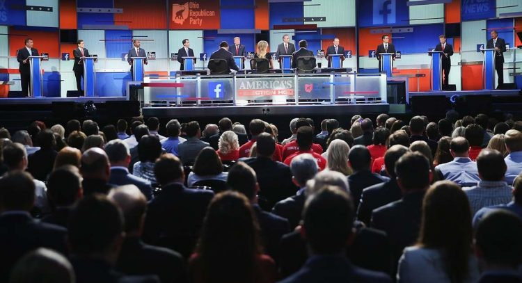 Guests watch Republican presidential candidates speak during the first Republican presidential debate hosted by Fox News and Facebook at the Quicken Loans Arena on August 6, 2015 in Cleveland, Ohio.