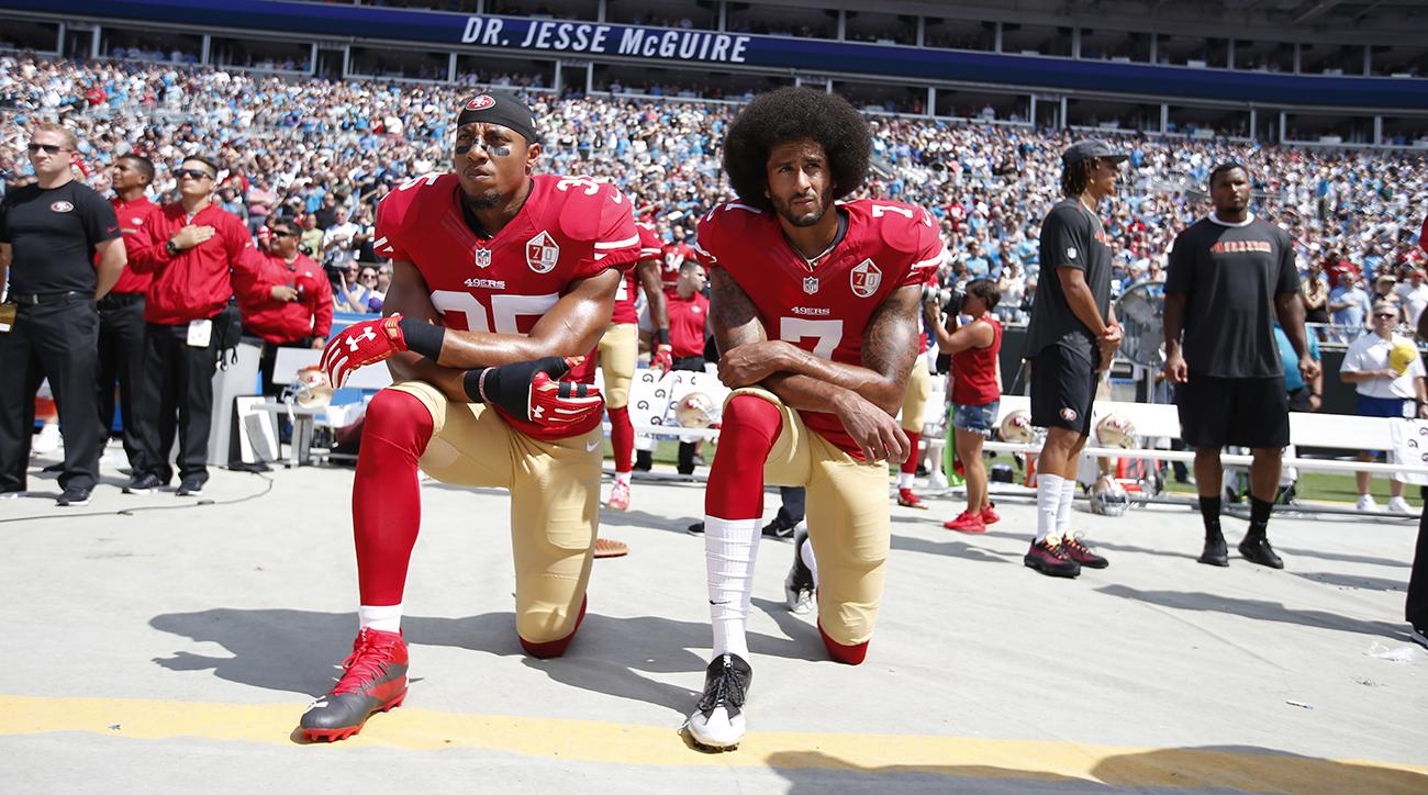 Colin Kaepernick and Jim Brown kneel during the National Anthem
