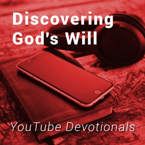 Bible, smart phone, headphones on table with text Discovering God's Will YouTube Devotionals