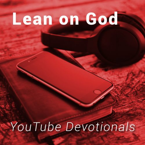 Bible, smart phone, headphones on table with text Lean on God YouTube Devotionals