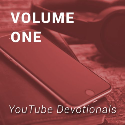 Bible, smart phone, headphones on table with text YouTube Devotionals Volume 1