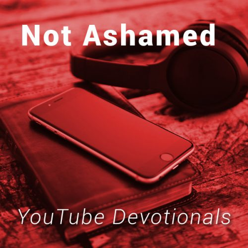 Bible, smart phone, headphones on table with text Not Ashamed YouTube Devotionals