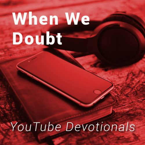 Bible, smart phone, headphones on table with text When We Doubt YouTube Devotionals