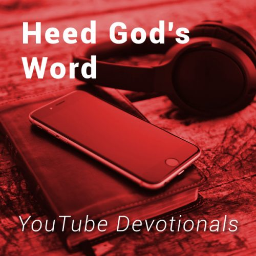 Bible, smart phone, headphones on table with text Heed God's Word YouTube Devotionals