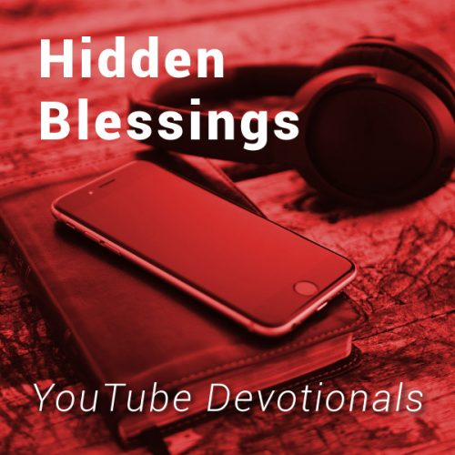 Bible, smart phone, headphones on table with text Hidden Blessings YouTube Devotionals