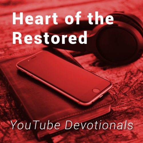 Bible, smart phone, headphones on table with text Heart of the Restored YouTube Devotionals