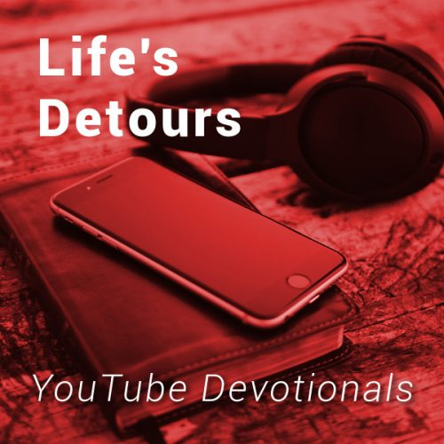 Bible, smart phone, headphones on table with text Life's Detours YouTube Devotionals
