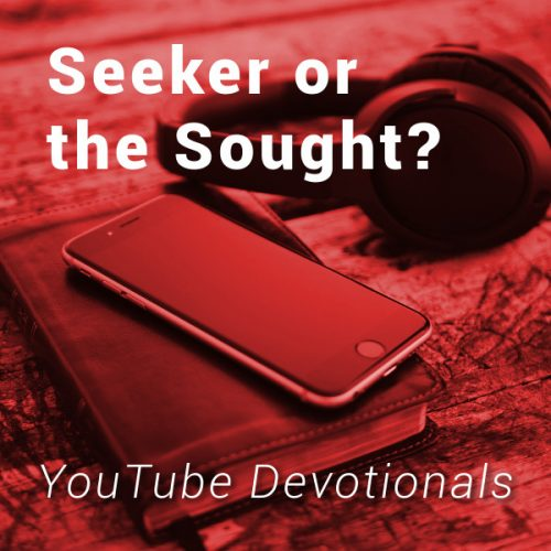 Bible, smart phone, headphones on table with text Seeker or the Sought YouTube Devotionals