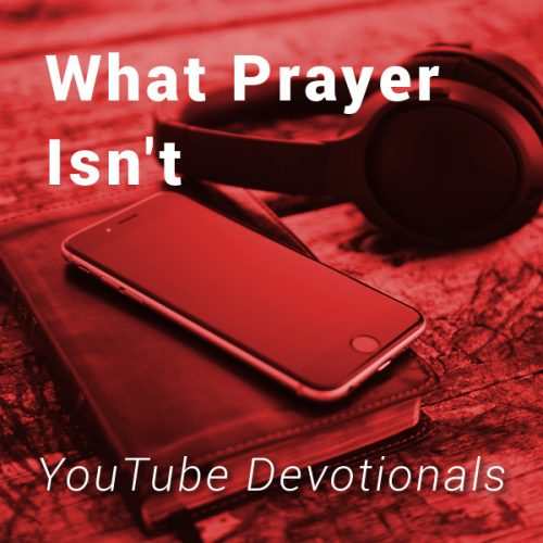 Bible, smart phone, headphones on table with text What Prayer Isn't YouTube Devotionals