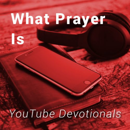 Bible, smart phone, headphones on table with text What Prayer Is YouTube Devotionals