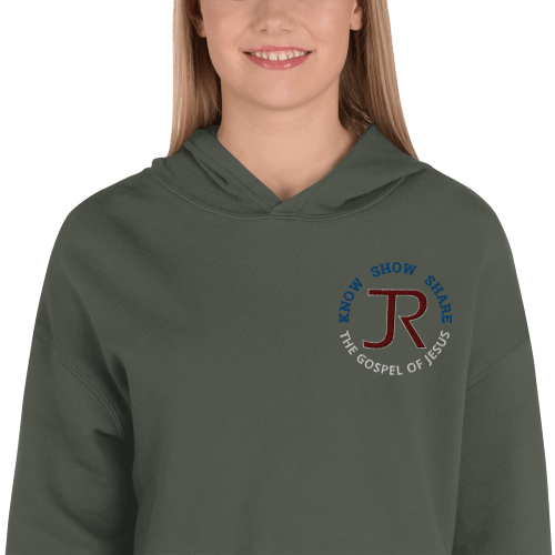 woman wearing hunter green fleece cropped hoodie with JR logo and know show share the gospel of Jesus