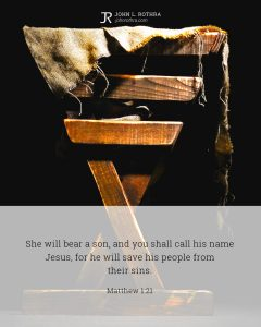 Bible meme quoting Matthew 1:21 with a wooden manger holding cloths