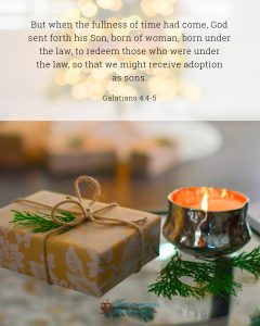 Bible meme quoting Galatians 4:4-5 with a candle next to a wrapped gift