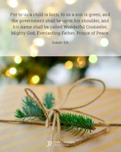 Bible meme quoting Isaiah 9:6 with pine twig tied to wrapped gift