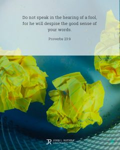 Bible meme quoting Proverbs 23:9 with crumpled yellow paper in metal trash can
