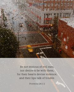 Bible meme quoting Proverbs 24:1-2 with city street viewed through rain-covered window