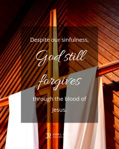quote meme about forgiveness with cross hanging in church