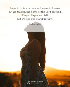 Bible meme quoting Psalm 20:-8 with woman in dress looking up at dusk