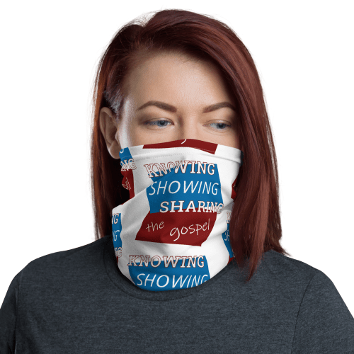 Woman wearing neck gaiter as face mask with Knowing Showing Sharing the gospel on blue and red background in a pattern