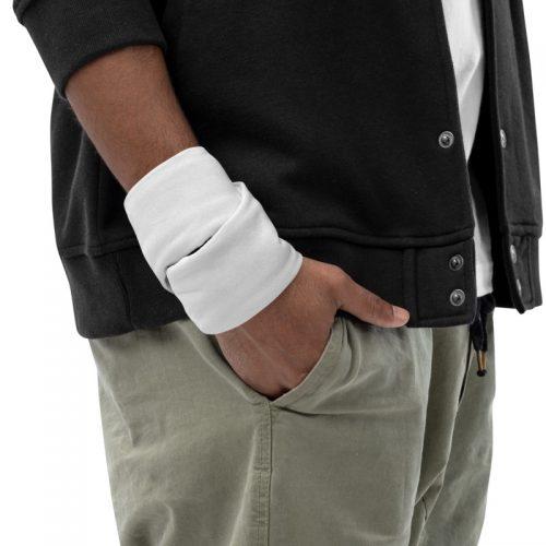 Man wearing neck gaiter as a wristband