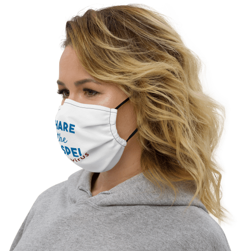 Woman wearing white face mask with black stitching with Share the gospel not a virus