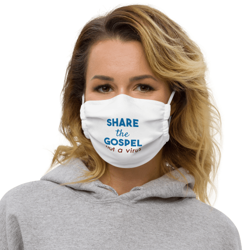 Woman wearing white face mask with white stitching with Share the gospel not a virus