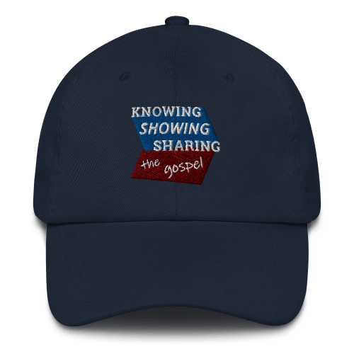 Navy blue baseball cap with Knowing Showing Sharing the gospel on blue and red background