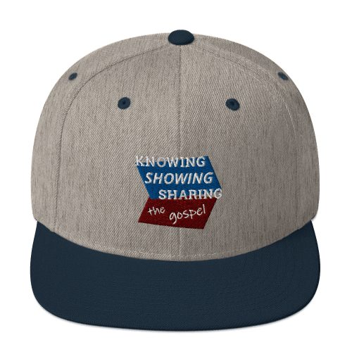 Navy blue and gray snapback hat with Knowing Showing Sharing the gospel on blue and red background