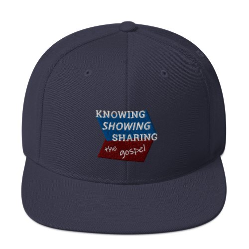 Navy blue snapback hat with Knowing Showing Sharing the gospel on blue and red background