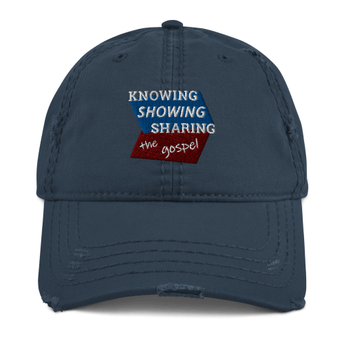 Navy blue distressed baseball cap with Knowing Showing Sharing the gospel on blue and red background