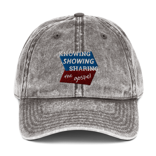 Gray denim-style baseball cap with Knowing Showing Sharing the gospel on blue and red background