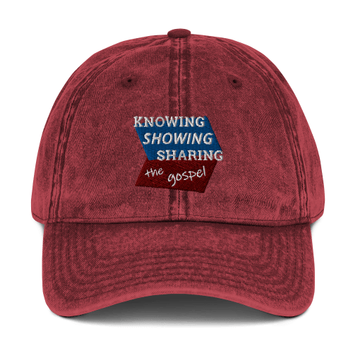 Red denim-style baseball cap with Knowing Showing Sharing the gospel on blue and red background