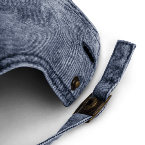 Snap and size adjustment clasp on back of blue denim-style baseball cap